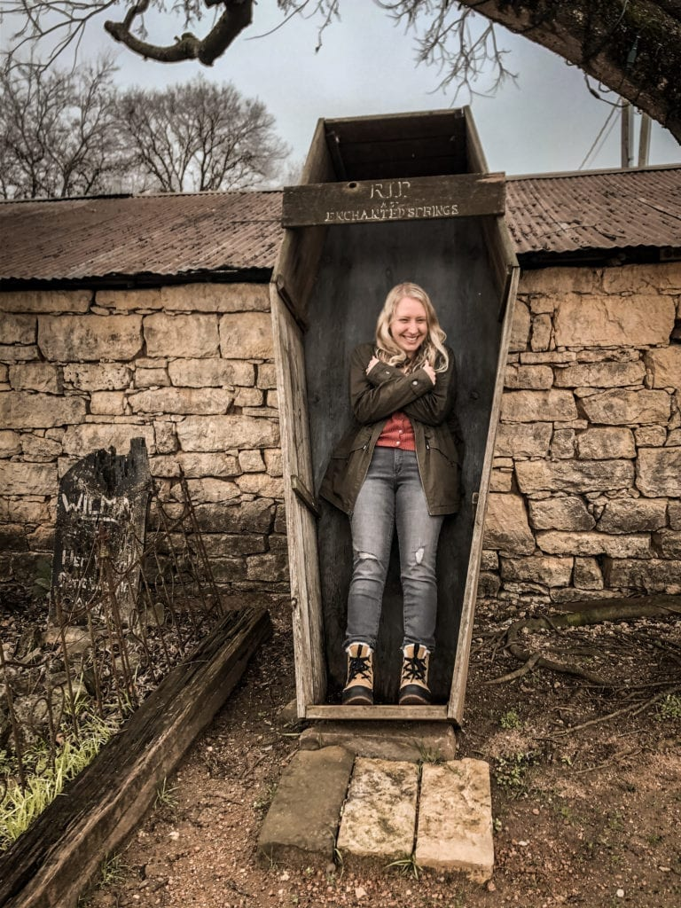 Take a photo in the coffin at Enchanted Springs Ranch